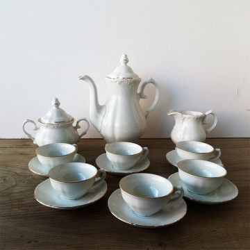 Set of  white porcelain coffee with a gold edge
